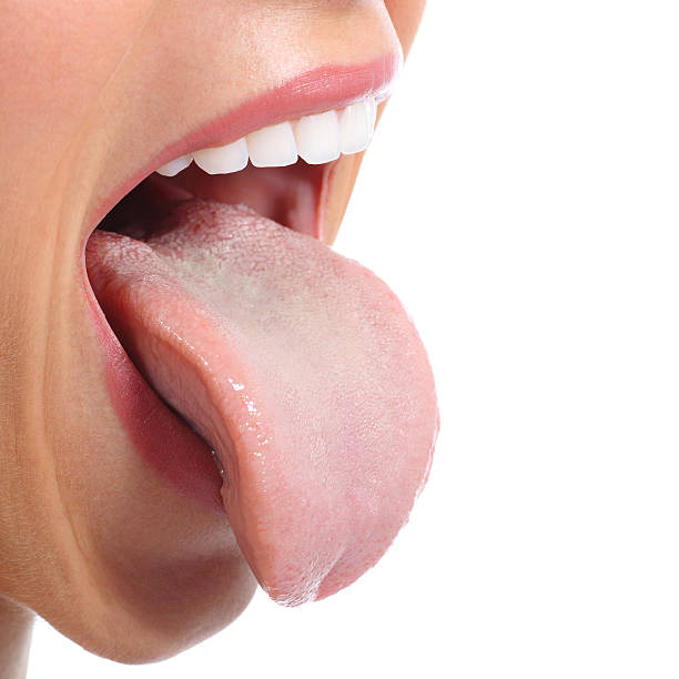 close up of a woman mouth sticking tongue - human saliva stock pictures, royalty-free photos & images