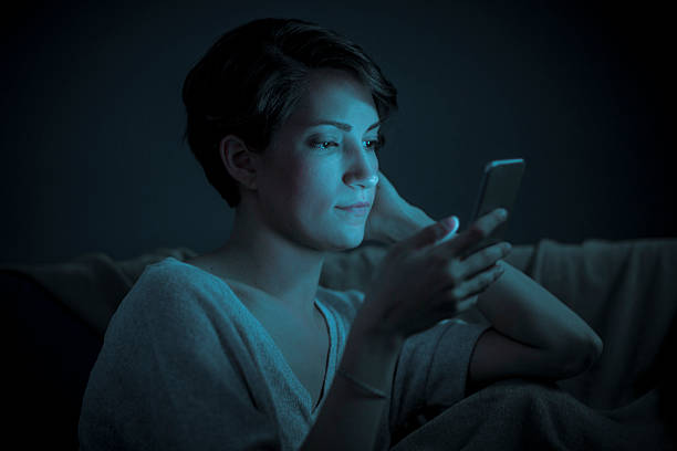 close up of a woman on her smart phone - smartphone addiction not groups stock pictures, royalty-free photos & images