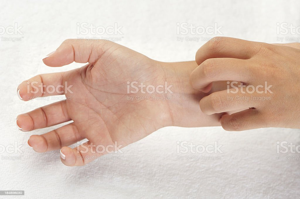 Close up of  a woman scratching royalty-free stock photo