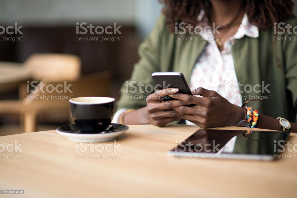 Close up of a woman using mobile phone stock photo