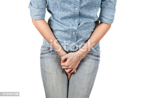 istock Close up of a woman with hands holding her crotch 475494796
