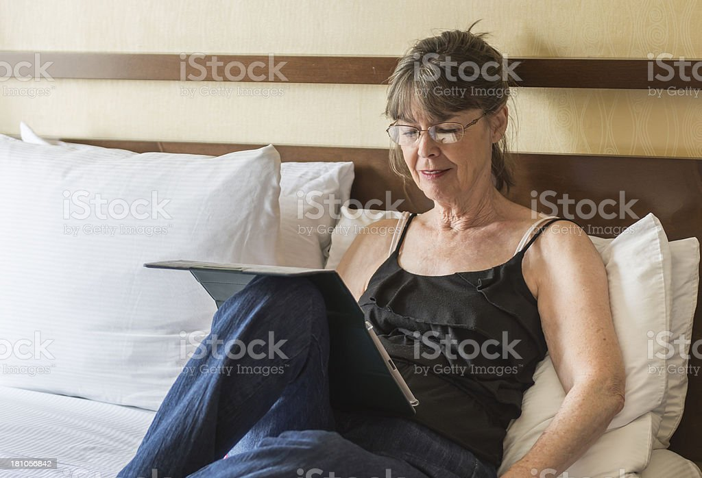 Close up of a woman working on digital tablet royalty-free stock photo