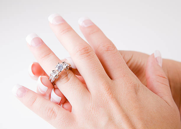 close up of a woman's hand - diamond ring hand stock photos and pictures