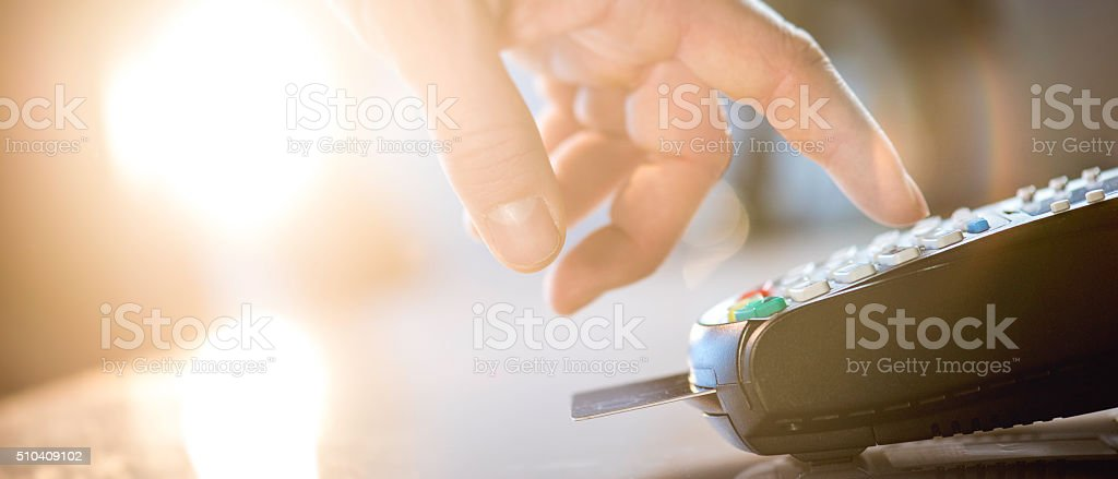Close up of a woman's hand typing on POS terminal stock photo