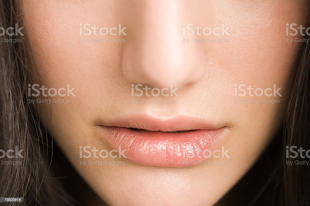 Close up of a womans nose and lips 免版稅 stock photo