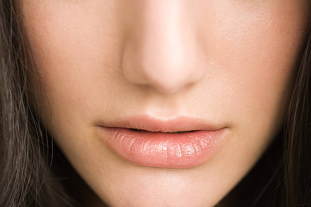 Close up of a womans nose and lips stock photo
