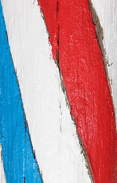 Close up of a wooden painted barber's pole stock photo