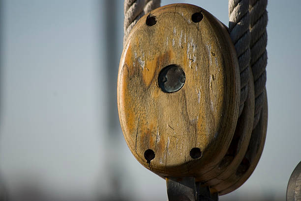 Close up of a wooden pulley stock photo