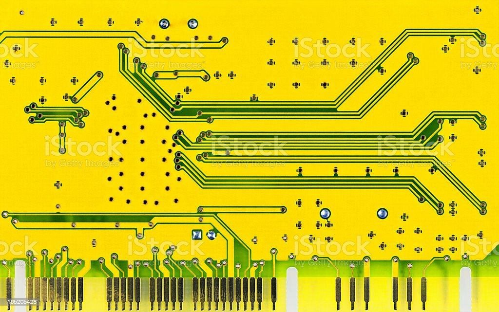 Close up of a yellow computer microcircuit royalty-free stock photo