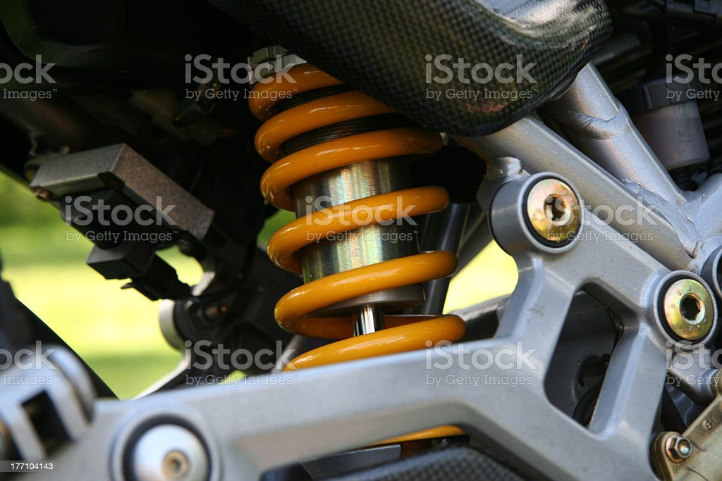 Close up of a yellow shock absorber royalty-free stock photo