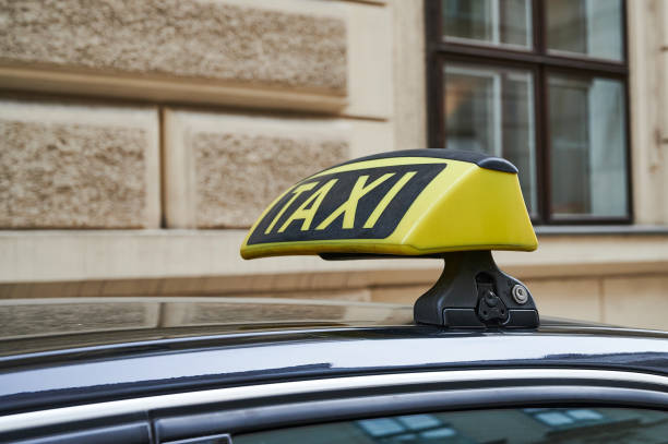 close up of a yellow taxi sign in front of a building in Vienna stock photo