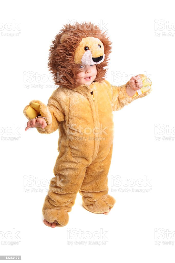 Close up of a young child in a lion costume stock photo