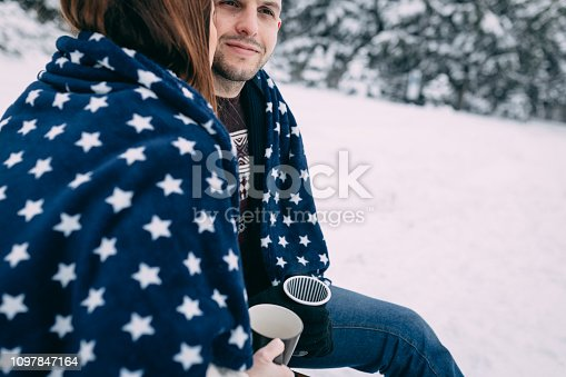 Close up of a young couple enjoying idyllic snowy day