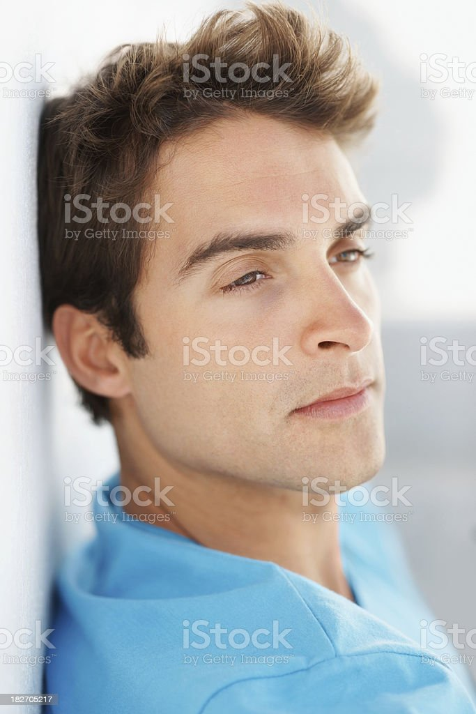Close up of a young man lost in thought royalty-free stock photo