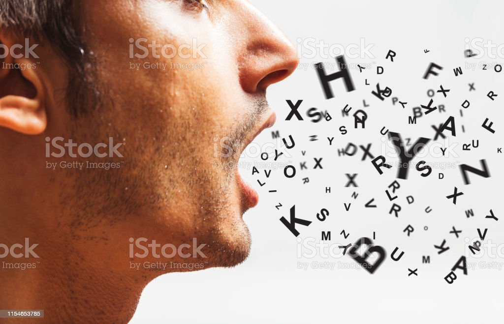 close up of a young man speaks - words power - watch your words concept close up of a young man speaks - words power - watch your words concept Adult Stock Photo