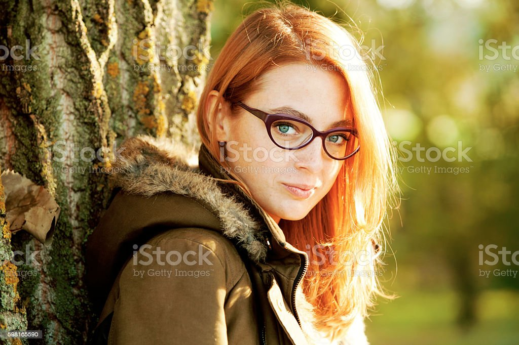 Close Up Of A Young Red Beautiful Girl Outdoor stock photo