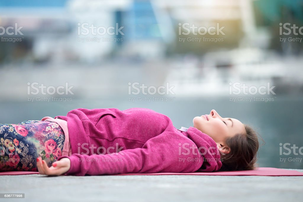 Close up of a young woman in Dead Body pose stock photo