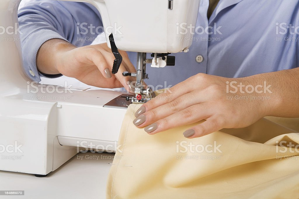 Close up of a young woman sewing royalty-free stock photo