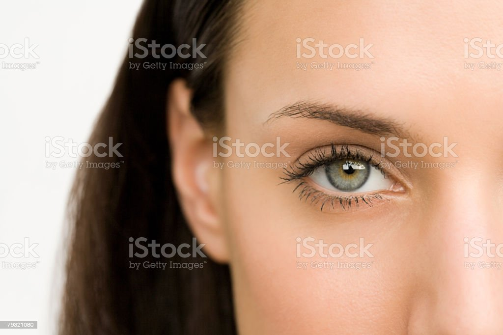 Close up of a young womans eye 免版稅 stock photo