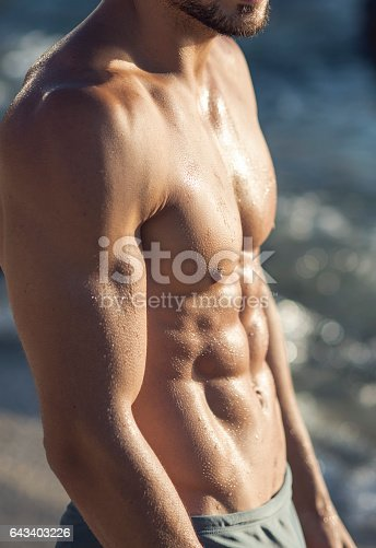519676858 istock photo close up of abdominal muscle of a man 643403226