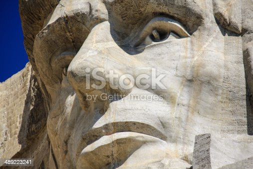1195382882istockphoto Close up of Abraham Lincoln at Mount Rushmore 489223241