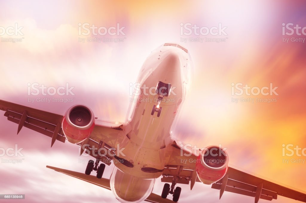 Close up of airplane and dramatic sky stock photo