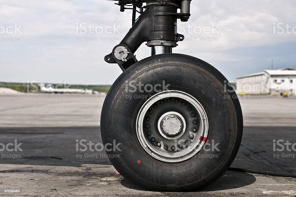Close up of airplane wheel on runway stock photo