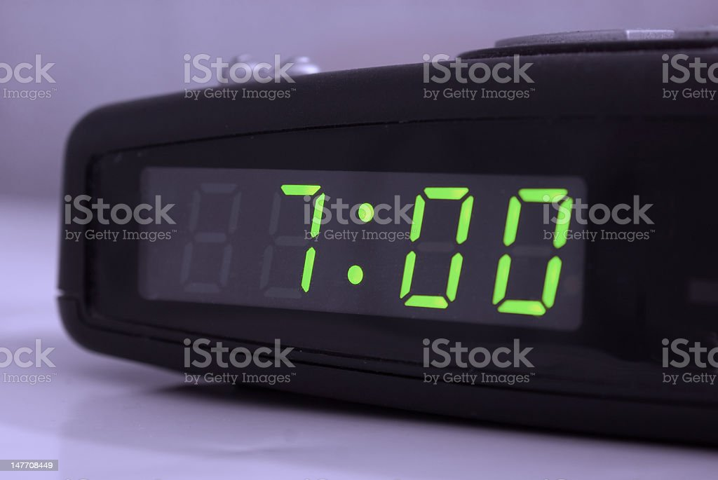 Close up of alarm clock set for 7am stock photo