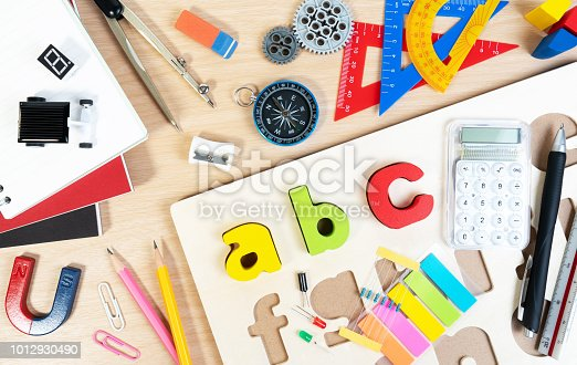 istock Close up of alphabet board game and basic equipment for elementary grade student for learning and playing. 1012930490