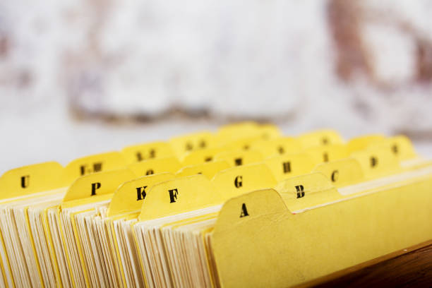 Close up of alphabetical index cards in box Close up of alphabetical index cards in a box telephone directory stock pictures, royalty-free photos & images