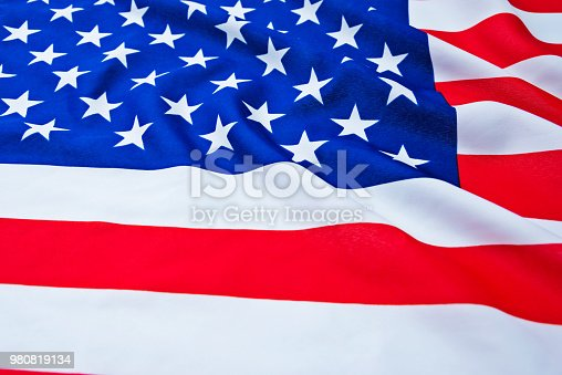 687972458 istock photo Close up of American flag 980819134