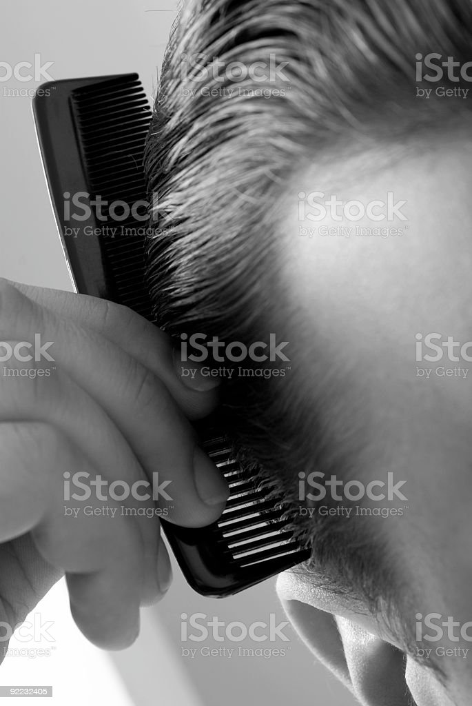 Close Up of American Man Combing Hair royalty-free stock photo