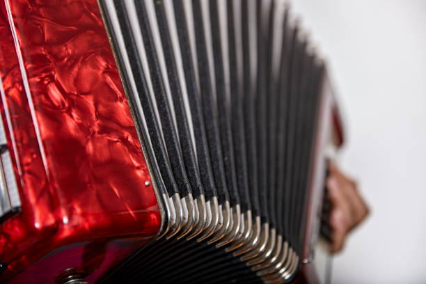 close up of an accordion and a womans hand - accordion stock photos and pictures