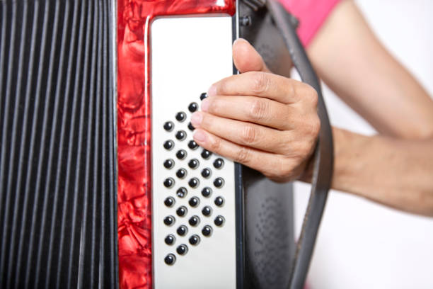 close up of an accordion and a womans hand stock photo