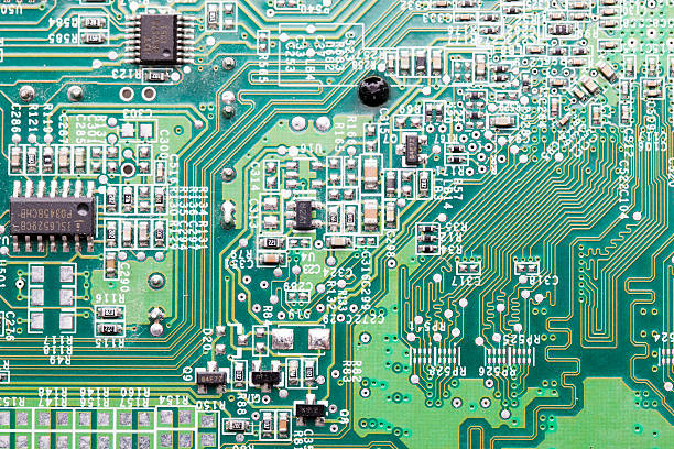 close up of an electric circuit board - mother board stock photos and pictures