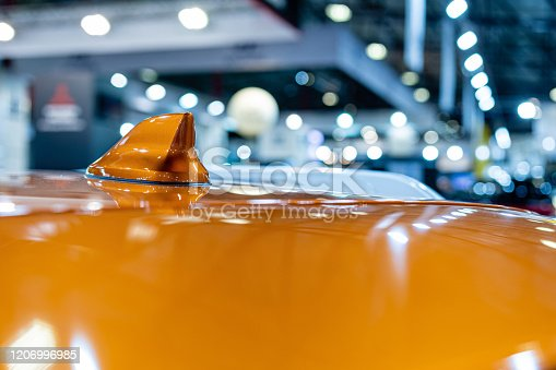 881639308 istock photo Close up of an FM AM GPS Navigation antenna placed on the roof of a vehicle.  Blurry defocused background. 1206996985