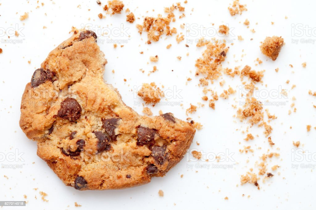 Close up of an half eaten cookie with crumb stock photo