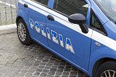 Blue police car with inscription police in Italian