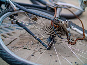 istock Close up of an old broken and bent bicycle with a rusted chain 1097967468