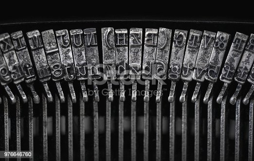 istock Close up of an old typewriter letters 976646760