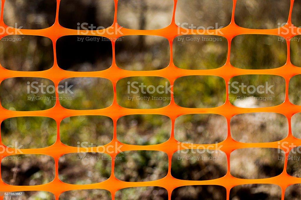 Close up of an orange plastic snow fence stock photo