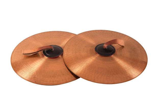 Close up of an prcussion cymbals Close up of an prcussion cymbals with leather handle  isolated on background. cymbal stock pictures, royalty-free photos & images