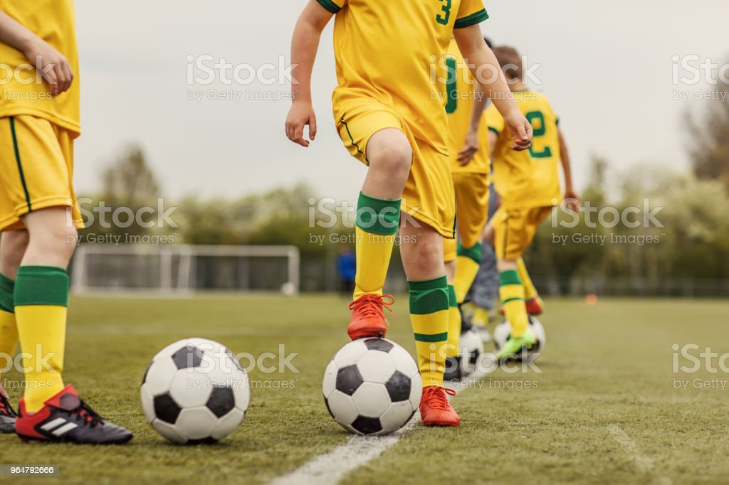A close up of an unidentified boys soccer team during an intense football training session royalty-free stock photo