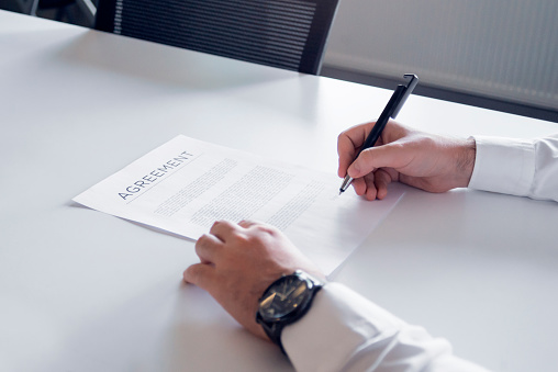 1072035844 istock photo Close up of an unrecognizable man signing a contract 1272876863