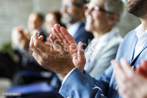 Close up of unrecognizable businessman clapping his hands on a seminar in board room.