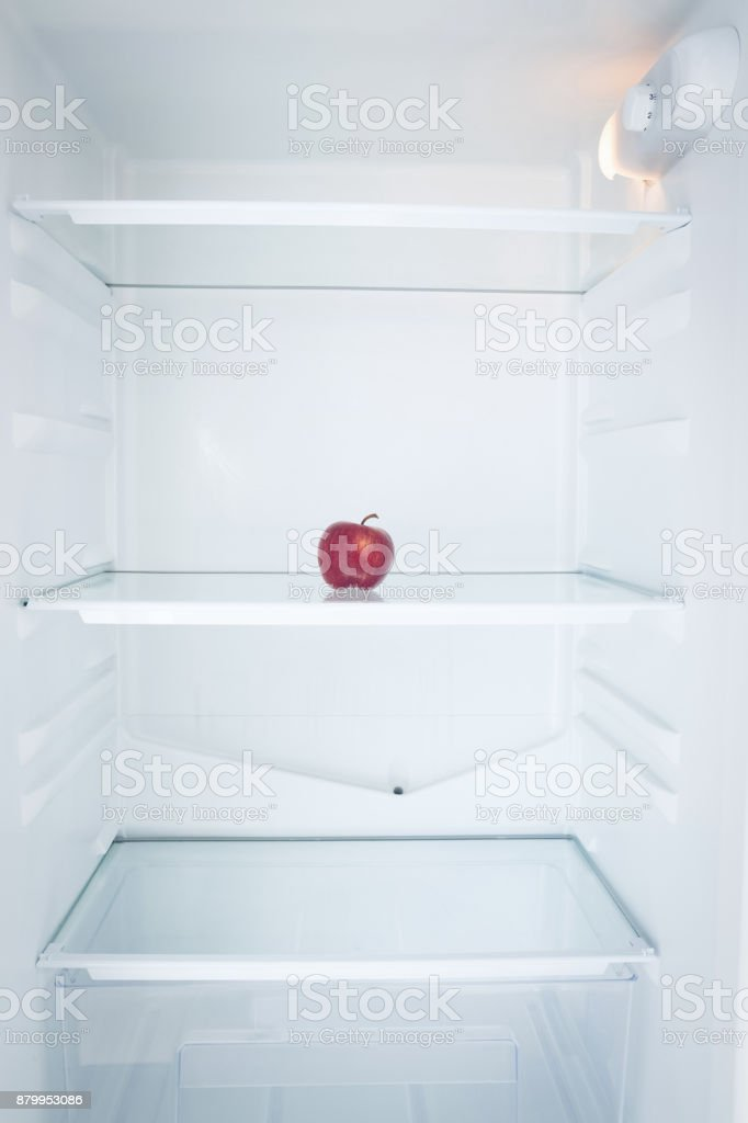 Close up of apple in open refrigerator stock photo