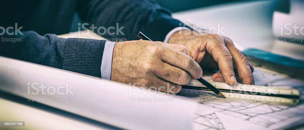 Close up  of architect drawing a plan stock photo