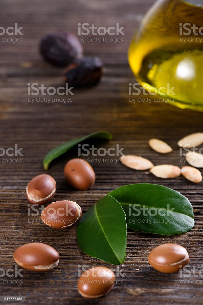 Close up of Argan fruits and oil stock photo