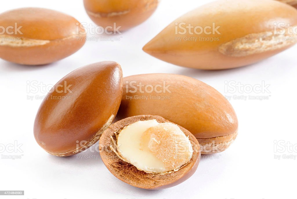 Close up of argan seeds on white background stock photo