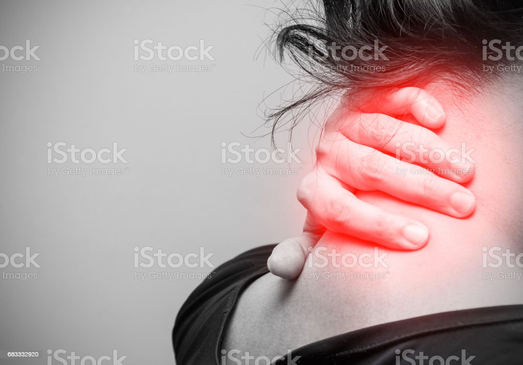 Close up of asian woman having neck pain, black and white photo stock photo